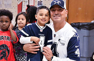 Pre-K students and their father figures are ready for the Superbowl after a morning of football-the